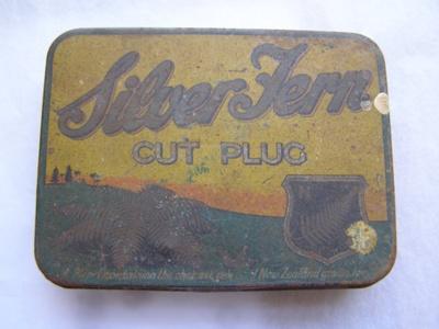 Yellow, Green, Orange painted metal tobacco tin wi...