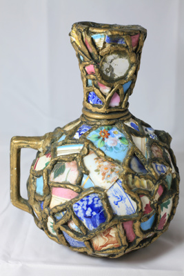 Handmade vase made from broken pieces of ceramics ...