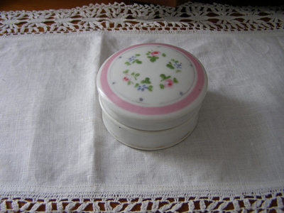 Small white ceramic container, pink and green flow...