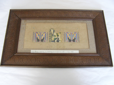 Framed illuminated calligrapy of initials 'M.H.M.'
