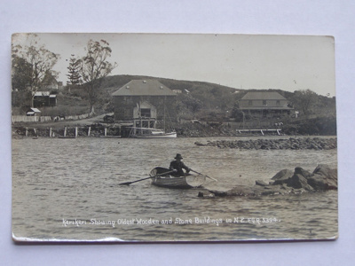 Real Photo Post Card Man rowing on the shore of ...