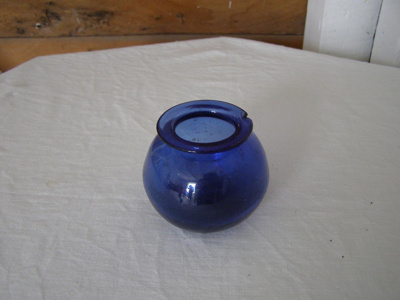 Small blue glass vase.