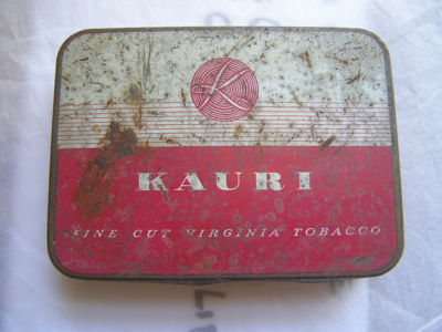 Kauri red and white painted metal tobacco tin co...