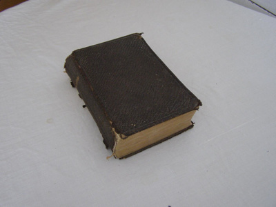 Black leather bound bible with gold edged pages.