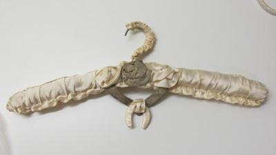 covered coat hanger; 1950; 2017.13.1.1