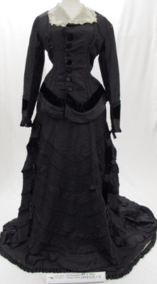 Black taffeta and velvet jacket and skirt c.1870's.; Unknown; c.1870's; 1997_625_1-2