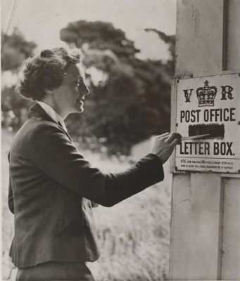 June Farley of Whatipu posting a letter in 1940., TC8412