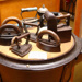A selection of irons rest on top of a copper., TC7383