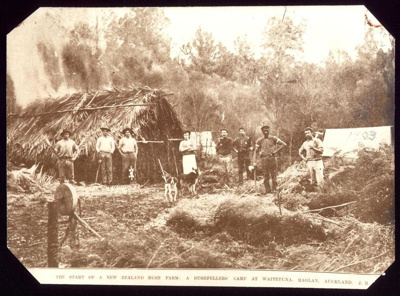 Bushfellers' and their dogs, stand in a clearing i...