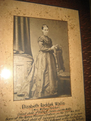 Framed photograph of Elizabeth Reddick Wallis.