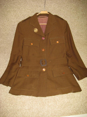 Jacket, skirt and badge of the NZ Womens Land Serv...