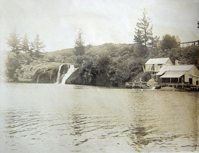 Photograph showing the Okete falls with Flax Mill ...