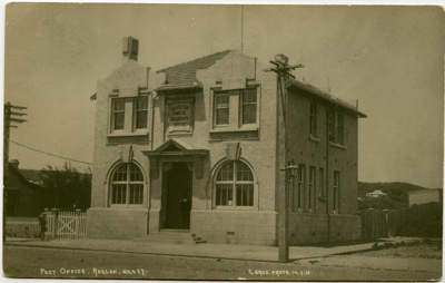 This photograph-postcard shows the old Raglan Post...