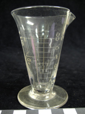 Glass measuring cup for medicines. Engraved measur...