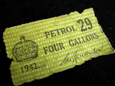 4 x war-time petrol coupons.