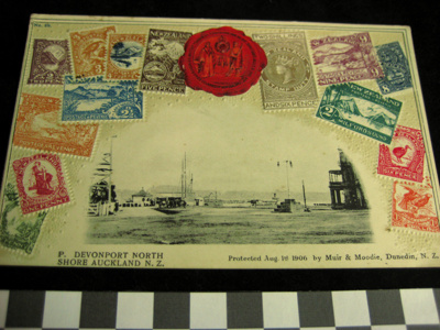 Postcard - with embossed old NZ stamps and a black...