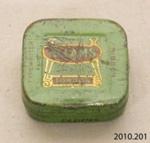Tin, typewriter ribbon; Ellams; [?]; 2010.201