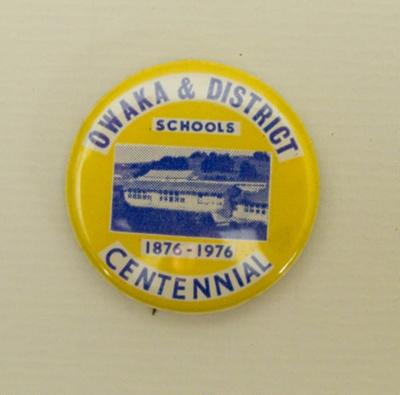 Badge, commemorative [Owaka and District Schools Centennial]; [?]; c1976; 2010.896