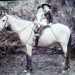 Alma and Aubrey Sarah on horseback.; 16-260