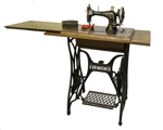 Treadle Sewing Machine with tin box of accessories.; 255