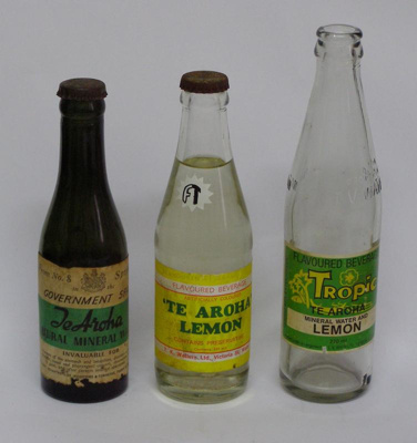 3 examples of glass mineral water bottles containi...