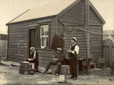 Miners outside hut; c1900; 40