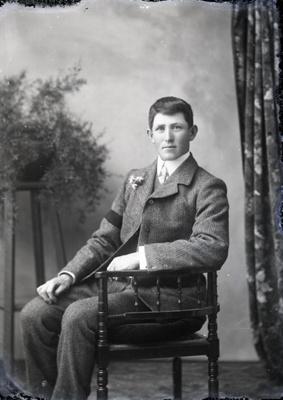 Male wearing black armband; 316