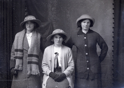 Three women in knitted clothes; 385