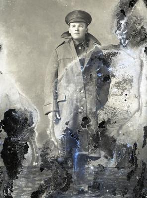 World War One soldier wearing great coat; 320