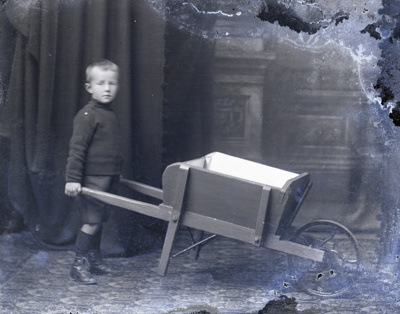 Boy with wheelbarrow; 130