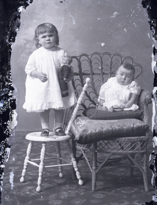 Baby and girl with knitted sailor doll; 666