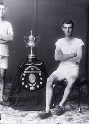 Athlete with trophies, McDugald; 454