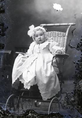 Baby in cane pram; 581