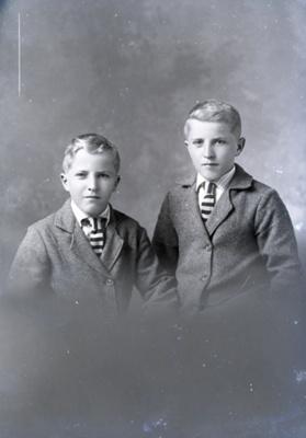 2 boys in school uniform Wells / Wills; 332