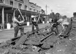 The first tracks to be removed, Jervois Road, Herne Bay, 1950s : four workmen; Graham C. Stewart (b.1932); 1950s; 06-1206