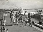 TEAL Steward, Stewardesses, passengers and children; Unknown Photographer; Apr 1947; 15-0142