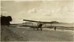 Black and white photograph of Avro 504K landing on the beach at Mission Bay; 1916-1920; 04/071/091