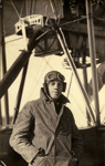 Black and white photograph of Fred Hyde, graduate of the Walsh Brothers Flying School, wearing pilot's clothing standing by a Walsh Flying boat