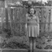 Girl standing on garden path; Unidentified; 1930s; 13-2127