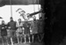 Black and white photograph of Walsh Brothers Flying School trainees beside a plane; 1915-1927; 04/077/007
