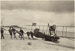 "Black and white photograph showing students of the Walsh Brothers Flying School pulling Curtiss ""C"" seaplane out of the water at Mission Bay; 1916-1924; 04/077/081"
