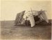 "Black and white photograph of Walsh Brothers' plane ""Manurewa"", crashed in a field; 1911; 04/077/037"