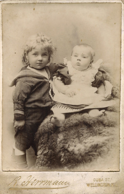 Portrait photograph of small child and a baby; R. Herrman; 13-1048