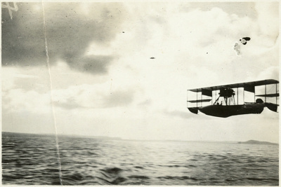 "Black and white photograph of Curtiss ""C"" flying boat from the Walsh Brothers Flying School flying over the water; 1916-1920; 04/071/095"