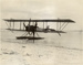 "Black and white photograph of one the Walsh Brothers Flying School Boeing seaplane ""F"" on the beach; 1916-1924; 04/077/060"