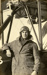 "Black and white photograph of R. H. Gray, graduate of the Walsh Brothers Flying School, wearing pilot's clothing standing by a ""Roberts"" flying boat; 1916-1920; 04/071/072"