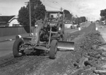The first tracks to be removed, Jervois Road, Herne Bay, 1950s : grader; Graham C. Stewart (b.1932); 1950s; 06-1205
