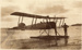 Black and white photograph of a Walsh Brothers Flying School seaplane sitting on the beach; 1915-1927; 04/077/026