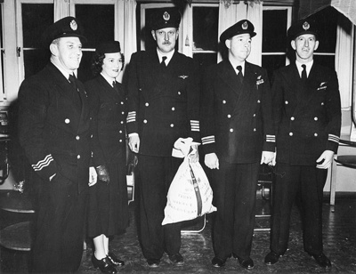 Crew of the first direct air service between Melbourne , Australia and Christchurch which was inaugurated  on the night of June 28 1951 when a Qantas Skymaster chartered by TEAL took off from Ess...