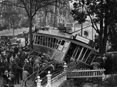 Tram no. 91 over the footpath with a broken fence in front of it where it has crashed through it; Unidentified; 1927?; 06-1185